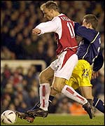 Bergkamp evades the challenge of Oxford's Steve Basham