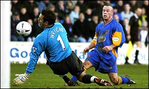 Everton's Richard Wright makes a save from Shrewsbury's Luke Rodgers