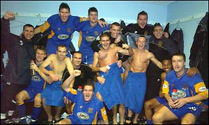 The Shrewsbury team celebrate their fantastic victory over Premiership Everton
