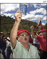Chavez supporter holds copy of Venezuelan constitution