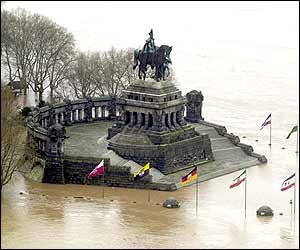 Famous landmark Deutsches Eck in Koblenz, western Germany lies partially submerged
