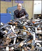 Sir John Stevens with haul of seized guns