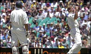 Australian bowler Brett Lee celebrates the wicket of England captain Nasser Hussain who is caught by Adam Gilchrist for 72