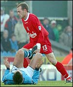 Liverpool's Danny Muprhy leaves City's Kevin Horlock flat on his back