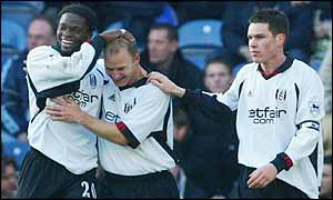 Bjarne Goldbaek is patted on the head by his team-mates after scoring Fulham's second goal