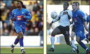 Ferdinand Coly runs during his debut for Birmingham and Louis Saha shields the ball