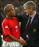 Mark Hughes congratulates Rob Earnshaw after he scores the winner against Germany