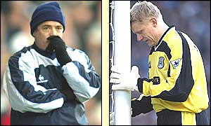 Manchester City boss Kevin Keegan looks thoughtful as Peter Schmeichel leans his head against a post