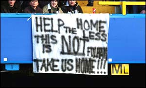 Fulham fans display a banner complaining about having no home ground of their own