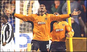 A delighted George Ndah celebrates having bundled the ball in from Lescott's header