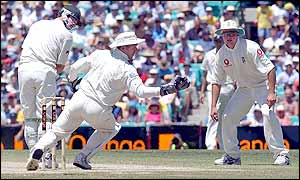 England wicket-keeper Alec Stewart makes the catch that dismisses Damien Martyn for 21 off the bowling of Richard Dawson