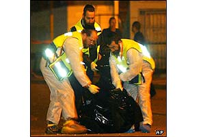 A special crew of orthodox Jewish emergency workers remove body parts from the scene