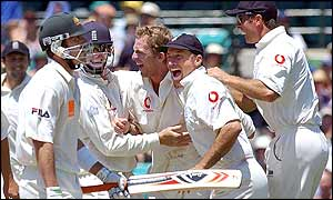 Damien Martyn leaves the field as England celebrate his dismissal