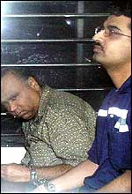 Suspects Muhammed Abid Afridi, right, of Pakistan and US citizen Ilyas Ali, left