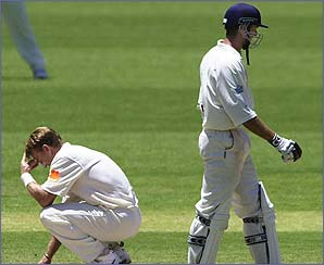 Andy Bichel sinks to his knees in frustration