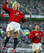 David Beckham celebrates his goal against Portsmouth