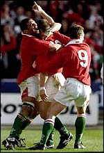 Scott Gibbs celebrates <I>that </I> try in 1999