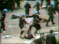 Photograph of police attacking demonstrators with batons