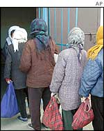 North Korean women queue for food, Chongjin city, North Hamgyong province of North Korea, November 2002.