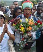 Hirut Gedlu is greeted with flowers in Addis Ababa