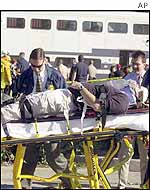 An injured passenger is removed from the scene by Burbank firefighters