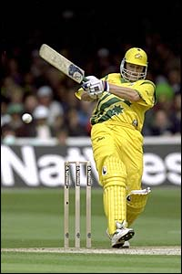 Australia's Adam Gilchrist smashes the ball towards the boundary