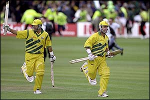 Australia's batsman Mark Waugh and Darren Lehmann run from the field after reaching their victory target