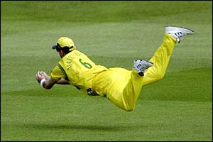 Mark Waugh takes a catch off the bowling of Glenn McGrath