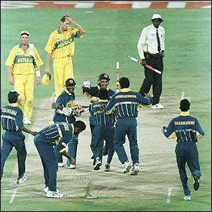 Arjuna Ranatunga and Aravinda De Silva are mobbed as their batting performance leads Sri Lanka to victory