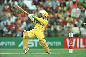 Australia's Mark Taylor hits the ball towards the boundary