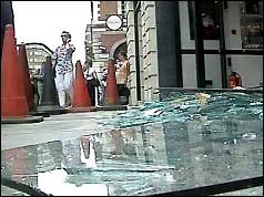 Photograph of shattered glass near the Israeli Embassy in London
