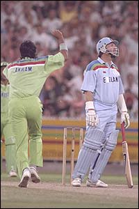 Pakistan's Wasim Akram snares Ian Botham for a duck