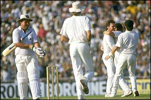 England's Mike Gatting is dismissed by Allan Border for 41