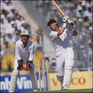 Australia's Dean Jones lofts a shot towards the boundary