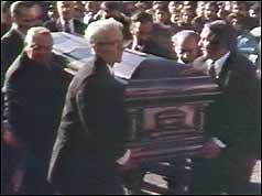 Carlo Gambino's coffin is carried into the church