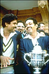 Mohinder Armanath and Kapil Dev of India parade the World Cup trophy