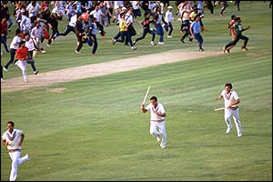 India's players run off the Lord's pitch after taking the final West Indies wicket