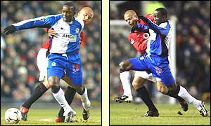 Blackburn's Dwight Yorke shields the ball from Wes Brown of Manchester United