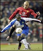 Blackburn's Andy Cole tussles with Man Utd's Wes Brown