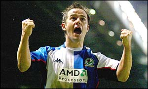 David Thompson clenches his raised fists to celebrate scoring Blackburn's equaliser