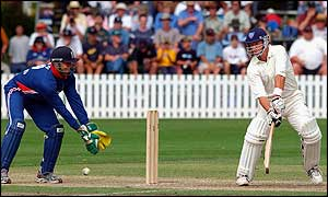 Mark Waugh hits the ball for four past England wicketkeeper Owais Shah