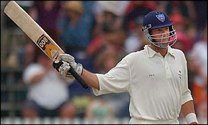 Mark Waugh celebrates reaching his century.