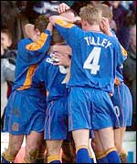 Shrewsbury players celebrate their FA Cup win over Everton