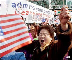 Waving US and South Korean flags, South Korean citizens shout slogans during a pro-US rally to support US military presence in South Korea