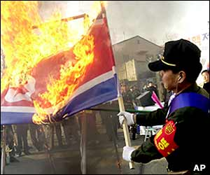 South Korean military veterans burn a North Korean national flag during their rally to support US military presence in South Korea