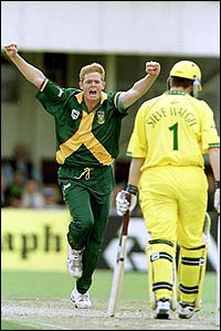 South Africa's Shaun Pollock celebrates taking the wicket of Australia's Steve Waugh