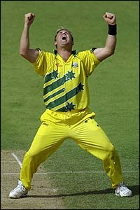 Shane Warne shows his delight at taking a wicket on his way to figures of 4-29