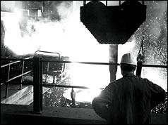 Steel worker in front of furnace