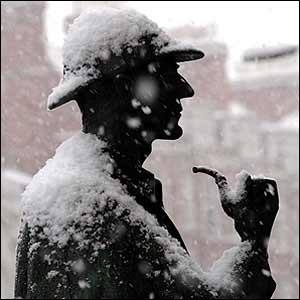 Statue of Sherlock Holmes covered in snow