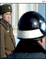 N Korean soldier eyes S Korean soldier on border